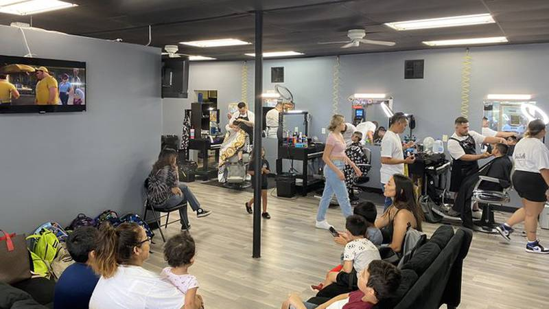 Ambitions Barber Shop giving free haircuts to kids.