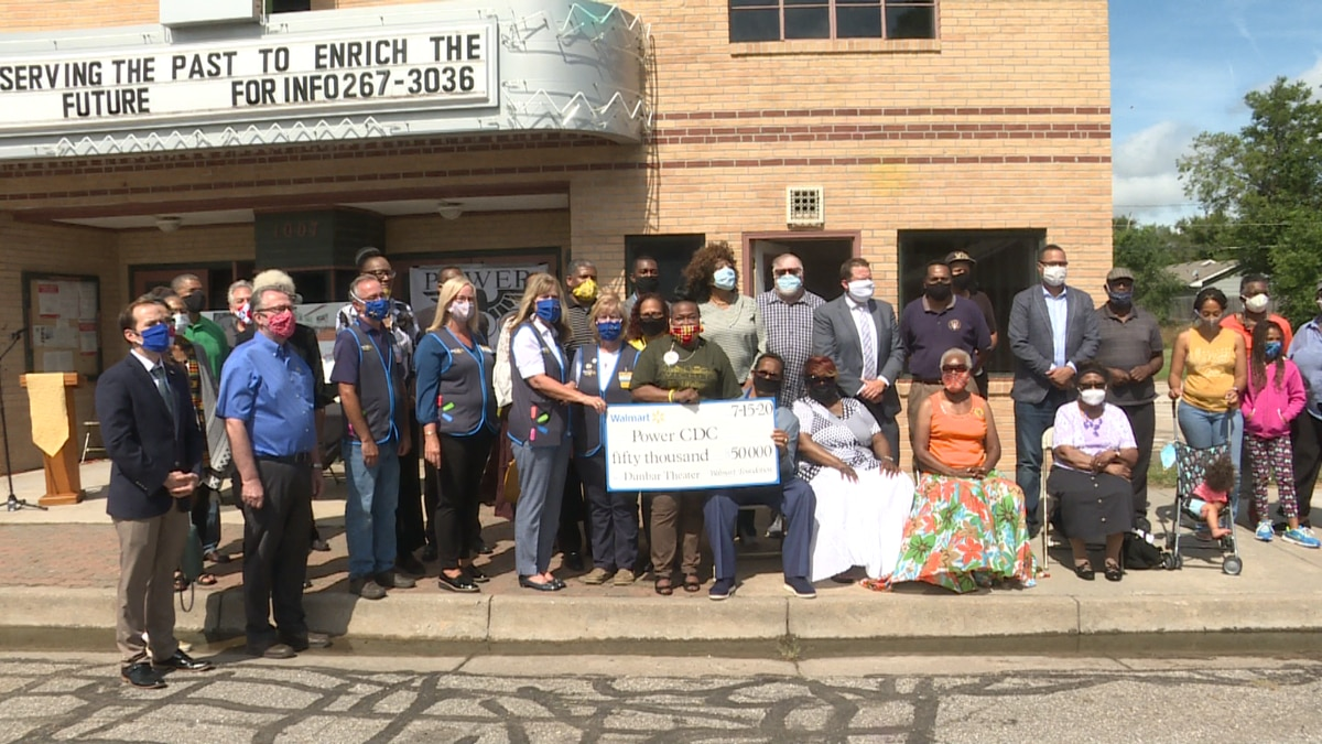 Walmart presented a $50,000 check to the Power Community Development Corporation (Power CDC) on Wednesday to support the Dunbar Theater restoration project in Wichita.