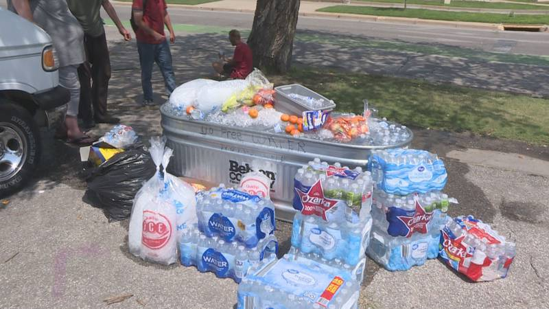 Wichita community donates ice and water to homeless during heat wave.