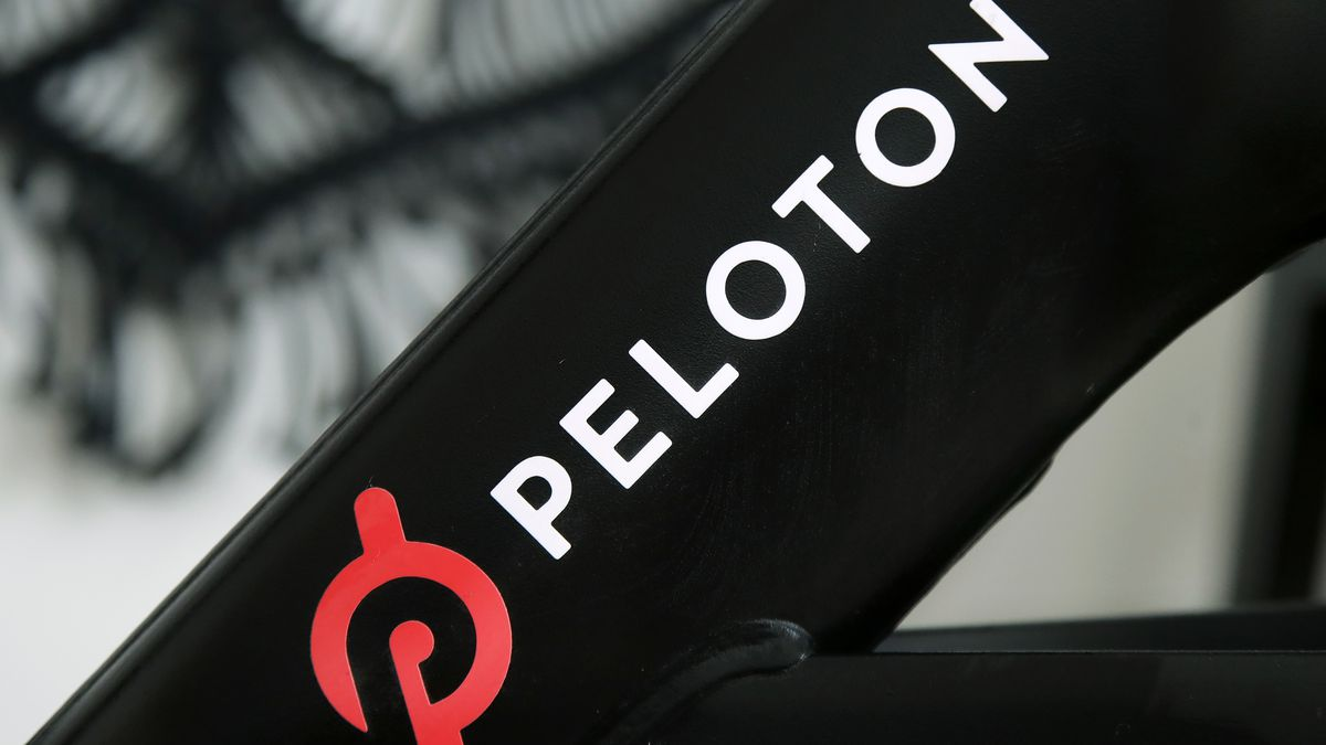 FILE - This Nov. 19, 2019 file photo shows a Peloton logo on the company's stationary bicycle...