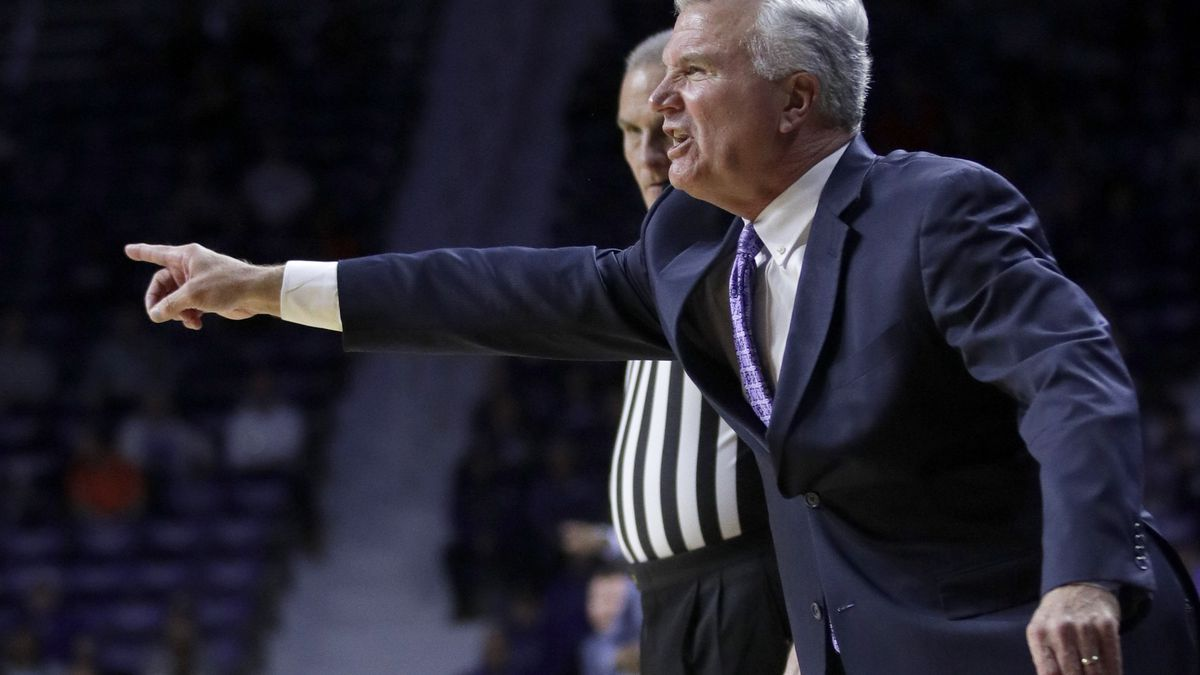 Kansas State head coach Bruce Weber directs his team during the first half of an NCAA college...
