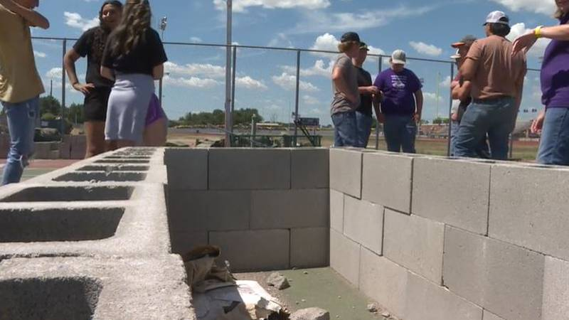 Lakin High School students are among community members working to convert an old tennis court...