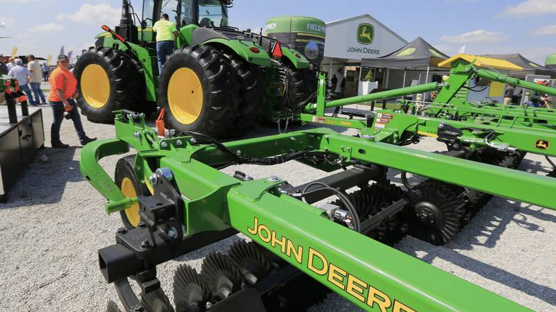 FILE - In this Sept. 10, 2019, file photo a John Deere tractor is on display at the Husker...