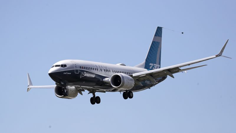A Boeing 737 Max jet heads to a landing at Boeing Field following a test flight on Monday, June...