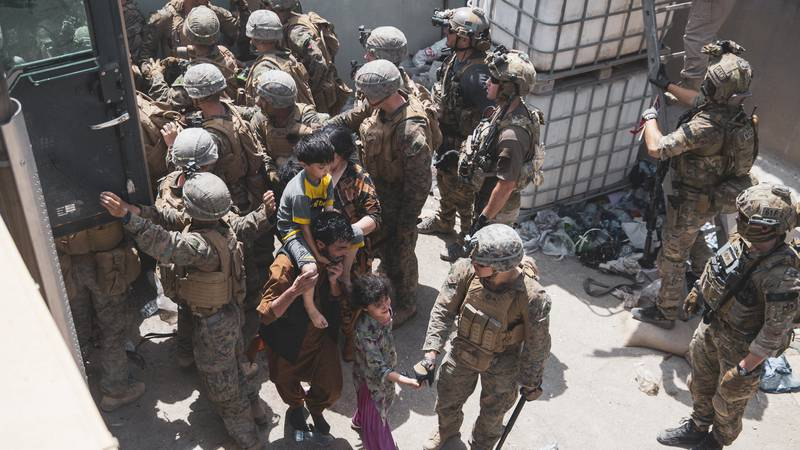FILE - In this Aug. 20, 2021 photo provided by the U.S. Marine Corps, U.S. Marines and...