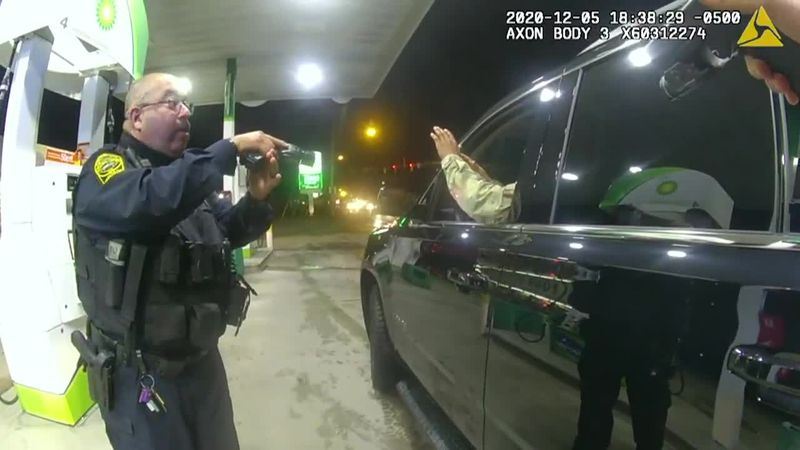 During the traffic stop, the police officers drew their guns, pointed them at the man and used...