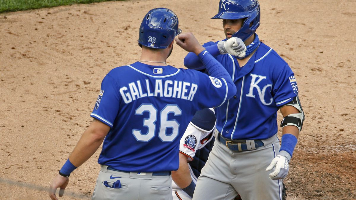 Kansas City Royals' Whit Merrifield celebrates with Cam Gallagher (36), who also scored, his three run home run against the Minnesota Twins in the fourth inning of game two of a baseball double-header Saturday, Aug. 15, 2020, in Minneapolis. The Royals won 4-2. (AP Photo/Bruce Kluckhohn)