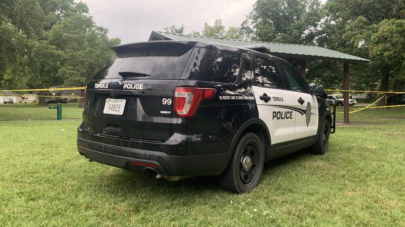 Topeka police were investigating the discovery of a man's body early Monday at a picnic table...