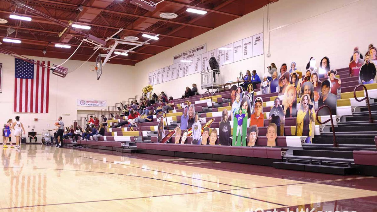 Printed cut outs of fans watch from the stands.  The Hugoton Lady Eagles defeated the Hays Lady...