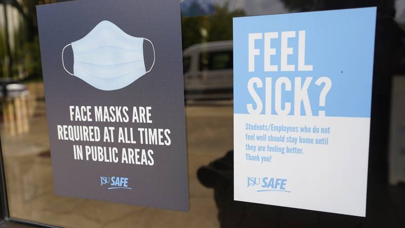 Face mask requirements are posted at the various entrances at the Rose E. McCoy Auditorium...