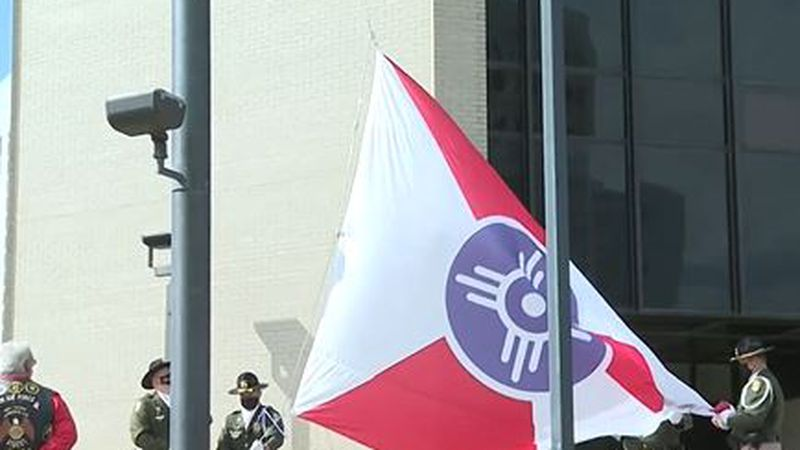 Flag for City of Wichita raised downtown.