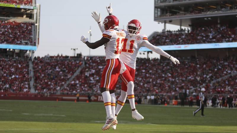 FILE - Kansas City Chiefs Demarcus Robinson (11) and Byron Pringle (13) celebrate a first half...