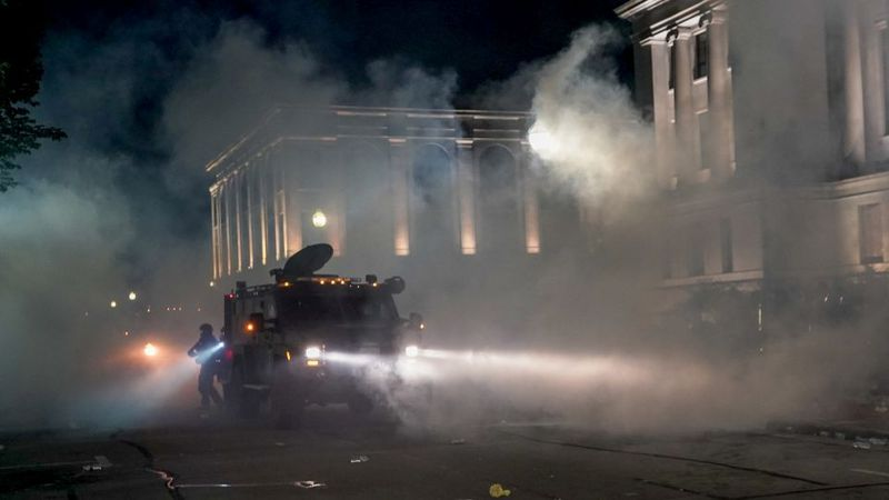 Police clash with protesters near the Kenosha County Courthouse, Monday, Aug. 24, 2020, in...