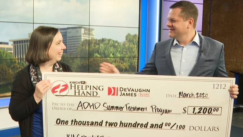 Richard James with DeVaughn James Injury Lawyers presents $1,200 Helping Hand to KU's Dr....