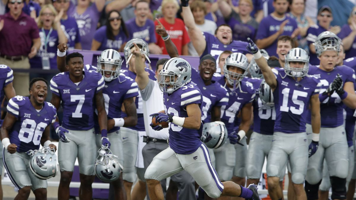 Kansas State kick return specialist Morgan Burns (33) runs past the K-State bench during a 103-yard kick return for a touchdown during the first half of an NCAA college football game against South Dakota in Manhattan, Kan., Saturday, Sept. 5, 2015. (AP Photo/Orlin Wagner)