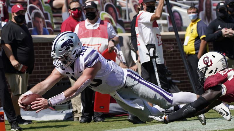 Kansas State quarterback Skylar Thompson (10) dives into the end zone for a touchdown in front...