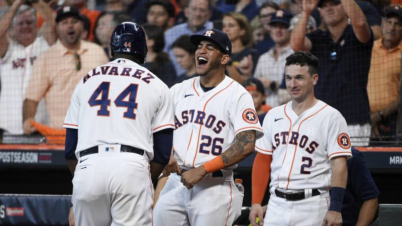 Houston Astros designated hitter Yordan Alvarez (44) reacts with Jose Siri (26) and Alex...