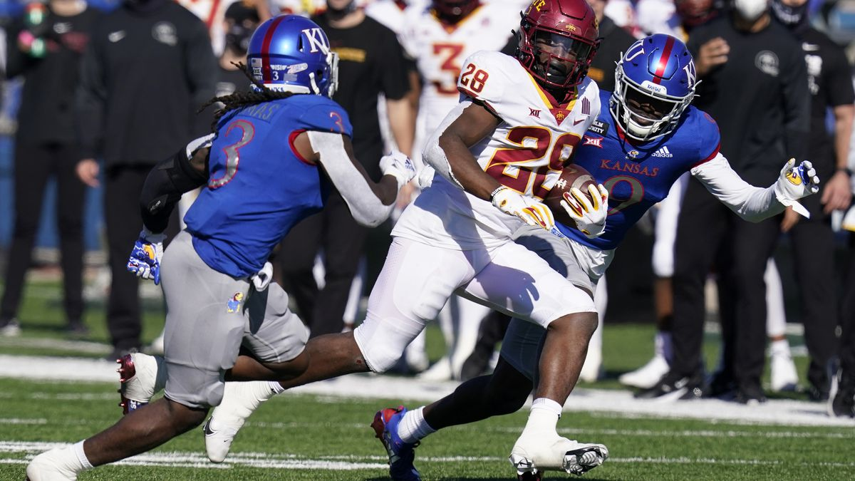 Iowa State running back Breece Hall (28) out runs Kansas safety Ricky Thomas (3) and cornerback...