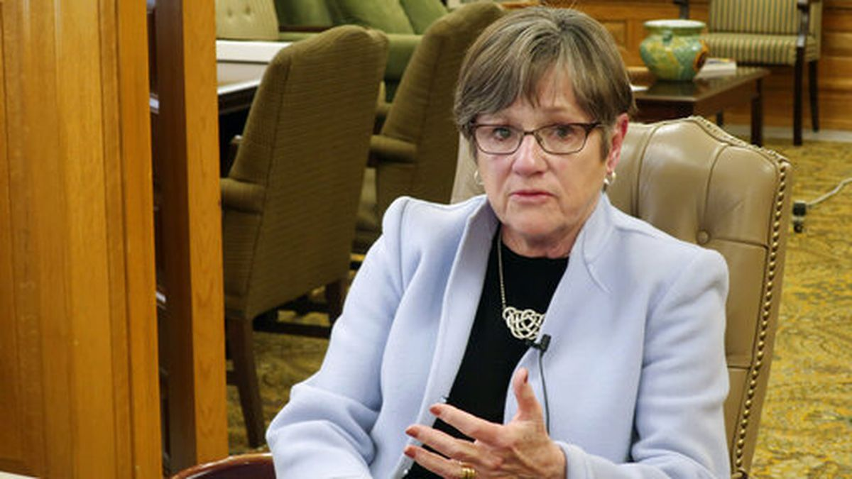 FILE - In this March 25, 2020 file photo, Kansas Gov. Laura Kelly answers questions in her...