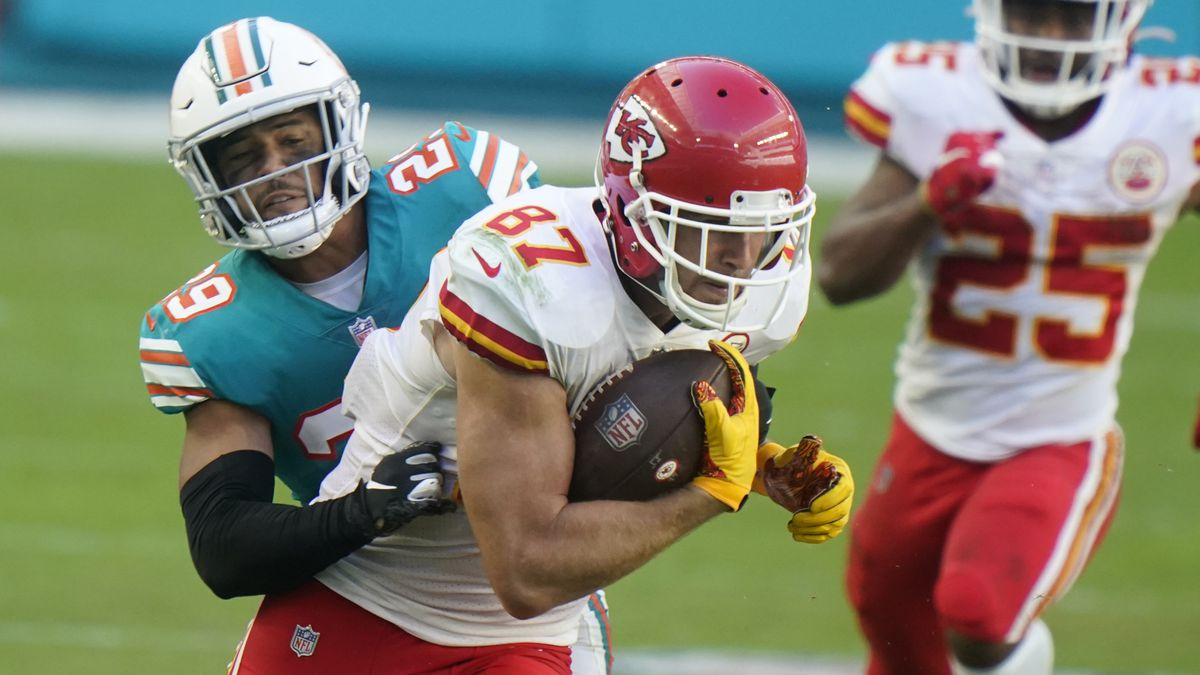 Miami Dolphins free safety Brandon Jones (29) attempts to bring down Kansas City Chiefs tight...