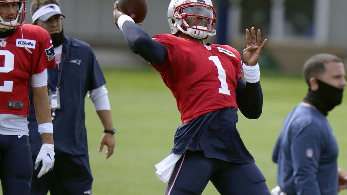 New England Patriots quarterback Cam Newton throws during an NFL football training camp...