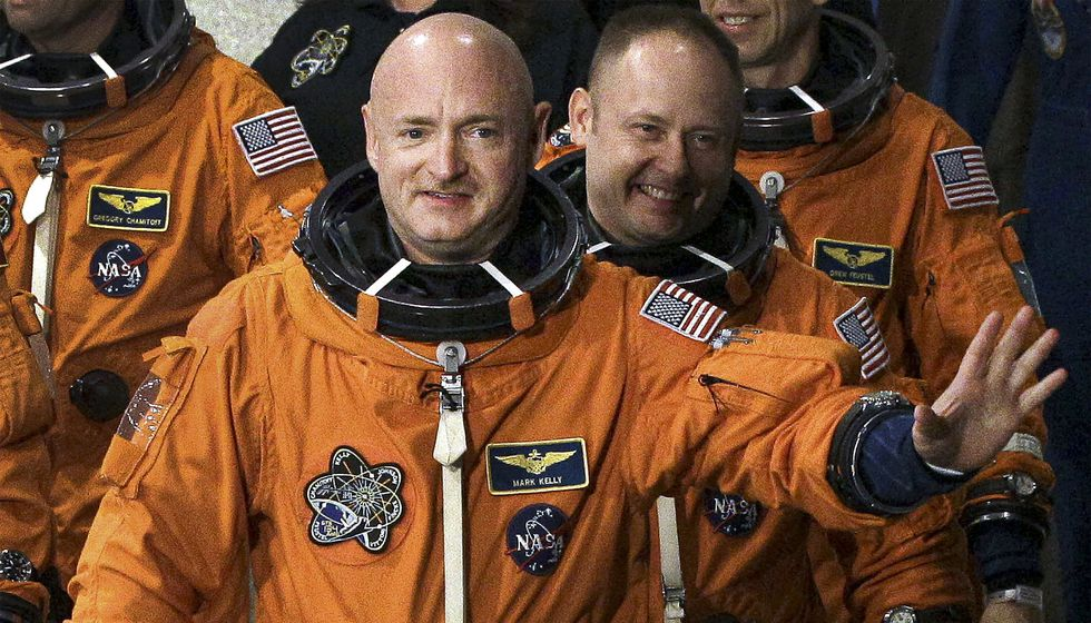 FILE - In this May 16, 2011 file photo, former NASA astronaut and STS-134 commander Mark Kelly, front, waves as he leaves the Operations and Checkout Building with fellow crew members, including Mike Fincke, for a trip to Launch Pad 39-A, and a planned liftoff on the space shuttle Endeavour at Kennedy Space Center in Cape Canaveral, Fla. A Kelly victory would shrink the GOP's Senate majority at a crucial moment and complicate the path to confirmation for President Donald Trump's Supreme Court nominee.