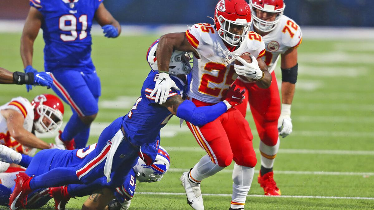 Kansas City Chiefs running back Clyde Edwards-Helaire, right, runs the ball during the first...