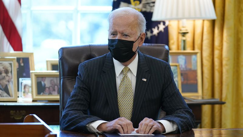 FILE - In this March 30, 2021 file photo, President Joe Biden speaks after signing the PPP...