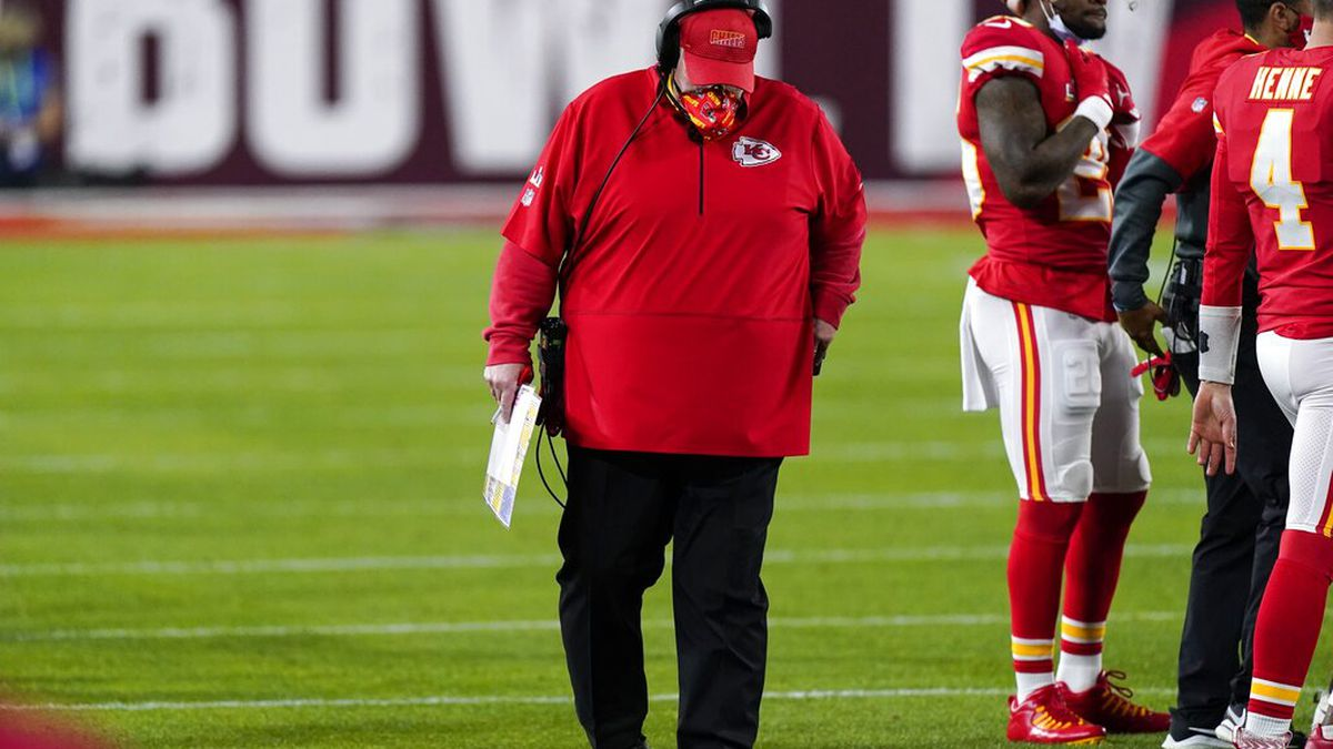 Kansas City Chiefs' Andy Reid hangs his head during the second half of the NFL Super Bowl 55...