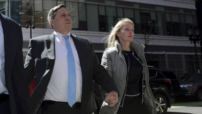 FILE - In this April 3, 2019 file photo, investor John Wilson, left, arrives at federal court...