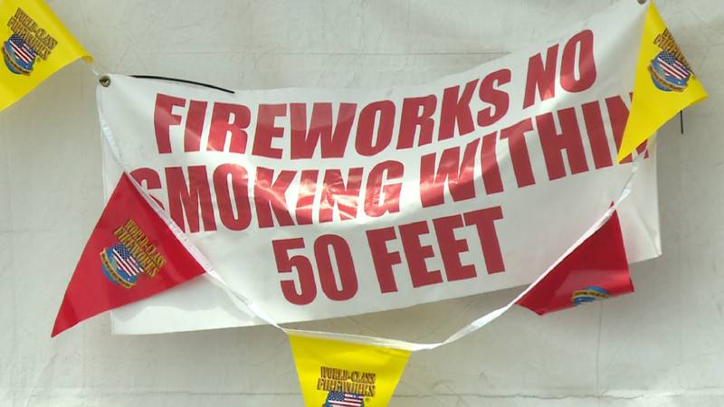 """A """"No Smoking"""" sign hangs at a fireworks tent in Sedgwick County, Kansas."""