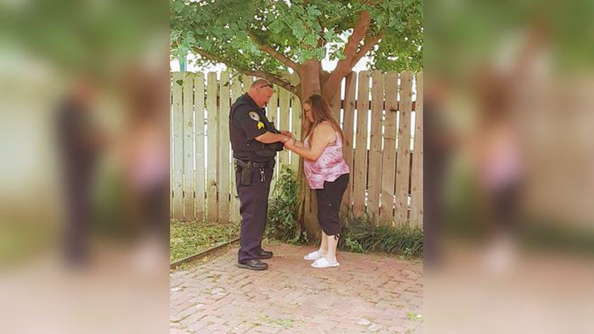 Mariposa Castanada shared this photo on her Facebook page showing a Hutchinson police officer that once arrested her, now praying for her.