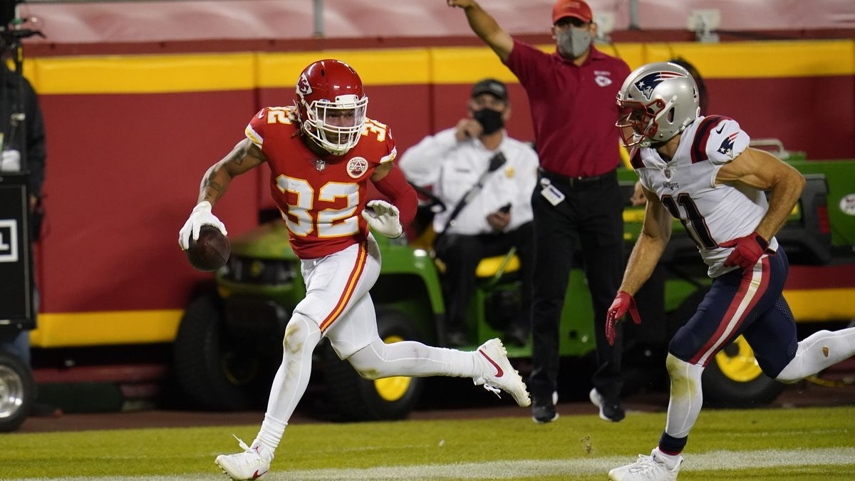 Kansas City Chiefs safety Tyrann Mathieu (32) runs from New England Patriots wide receiver Julian Edelman, right, while returning an interception 25-yards for a touchdown during the second half of an NFL football game, Monday, Oct. 5, 2020, in Kansas City. (AP Photo/Jeff Roberson)