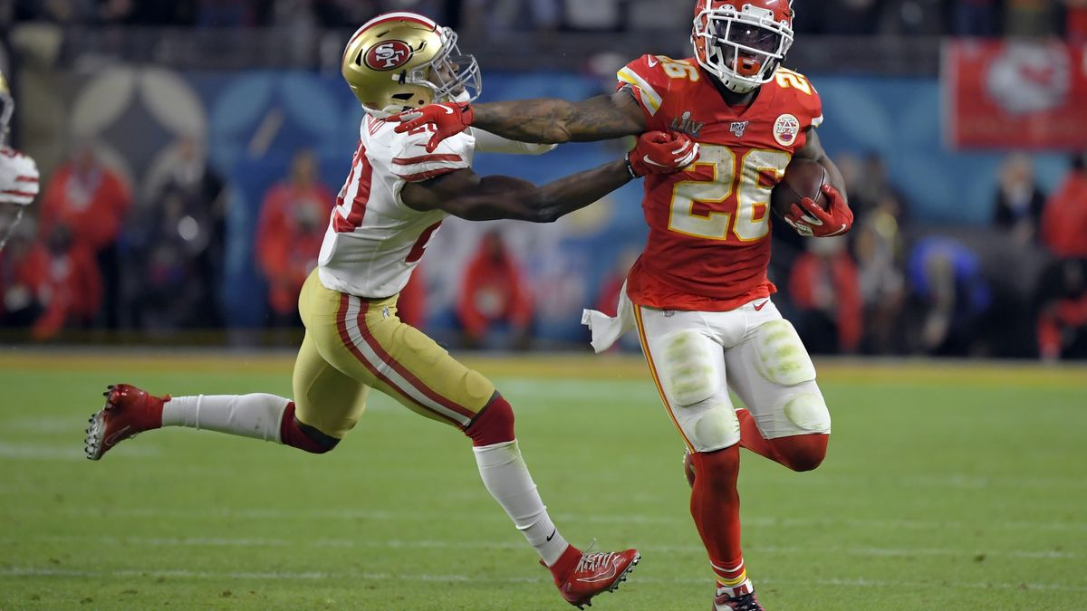 CORRECTS THE WINNING TOUCHDOWN TO THE FINAL TOUCHDOWN - Kansas City Chiefs' Damien Williams, right, pulls away from San Francisco 49ers' Jimmie Ward on his way to the final touchdown during the second half of the NFL Super Bowl 54 football game Sunday, Feb. 2, 2020, in Miami Gardens, Fla. (AP Photo/Mark J. Terrill)