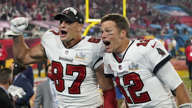 Tampa Bay Buccaneers tight end Rob Gronkowski, left, and quarterback Tom Brady celebrate after...