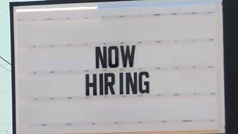 """""""Now Hiring"""" sign at a business in Wichita, Kansas"""