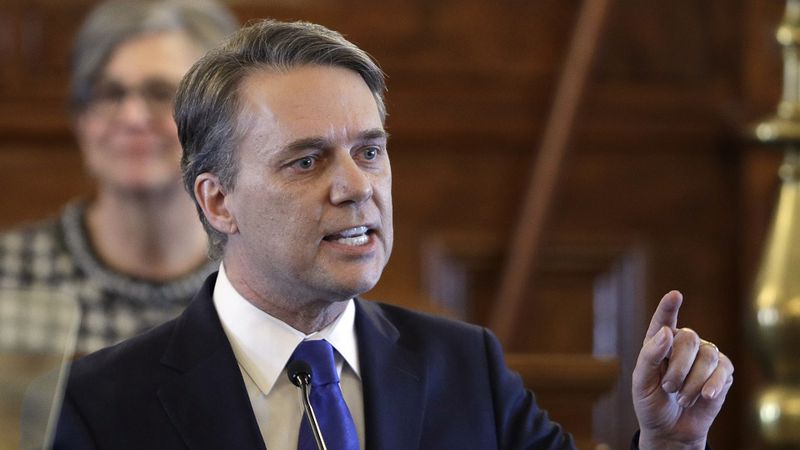Gov. Jeff Colyer speaks to a joint session of the Kansas Legislature at the Statehouse in...