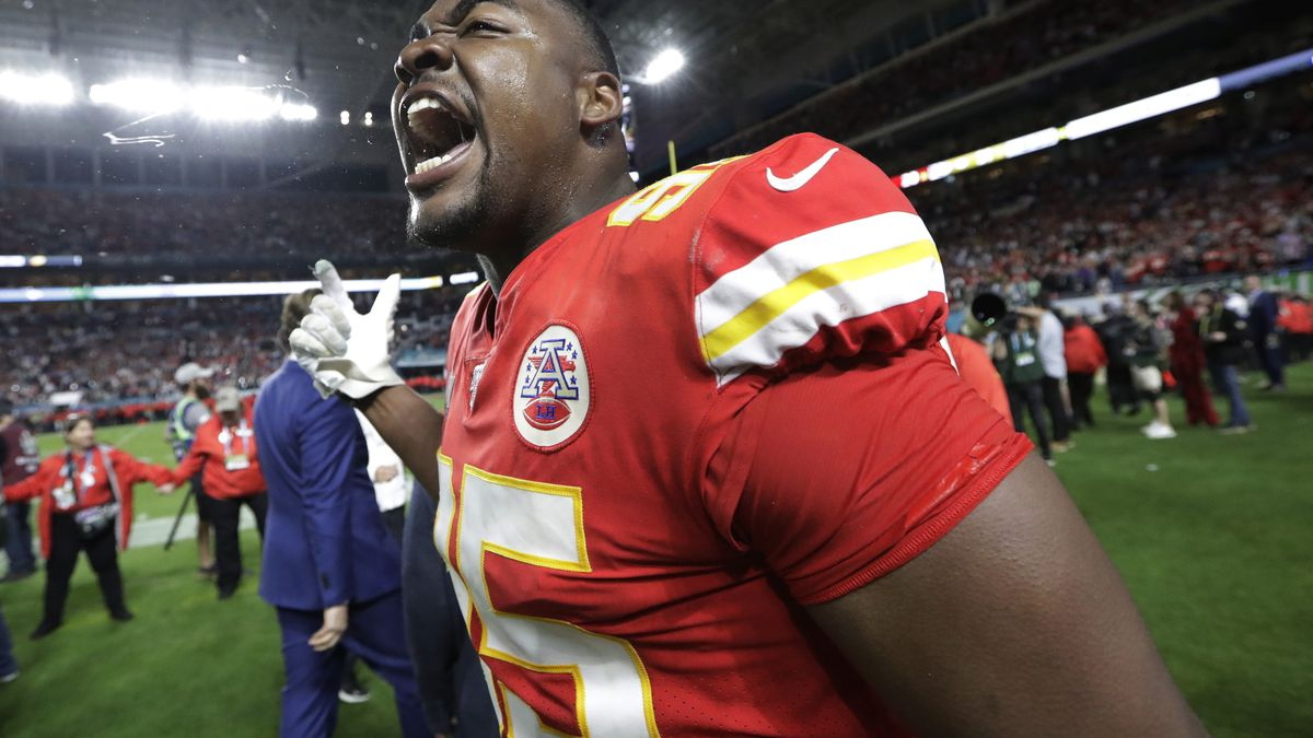 Kansas City Chiefs' Chris Jones (95) celebrates during the second half of the NFL Super Bowl 54...
