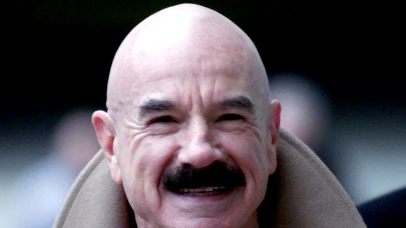 FILE This Jan. 16, 2001 file photo shows  G. Gordon Liddy, a Watergate conspirator, arriving at...
