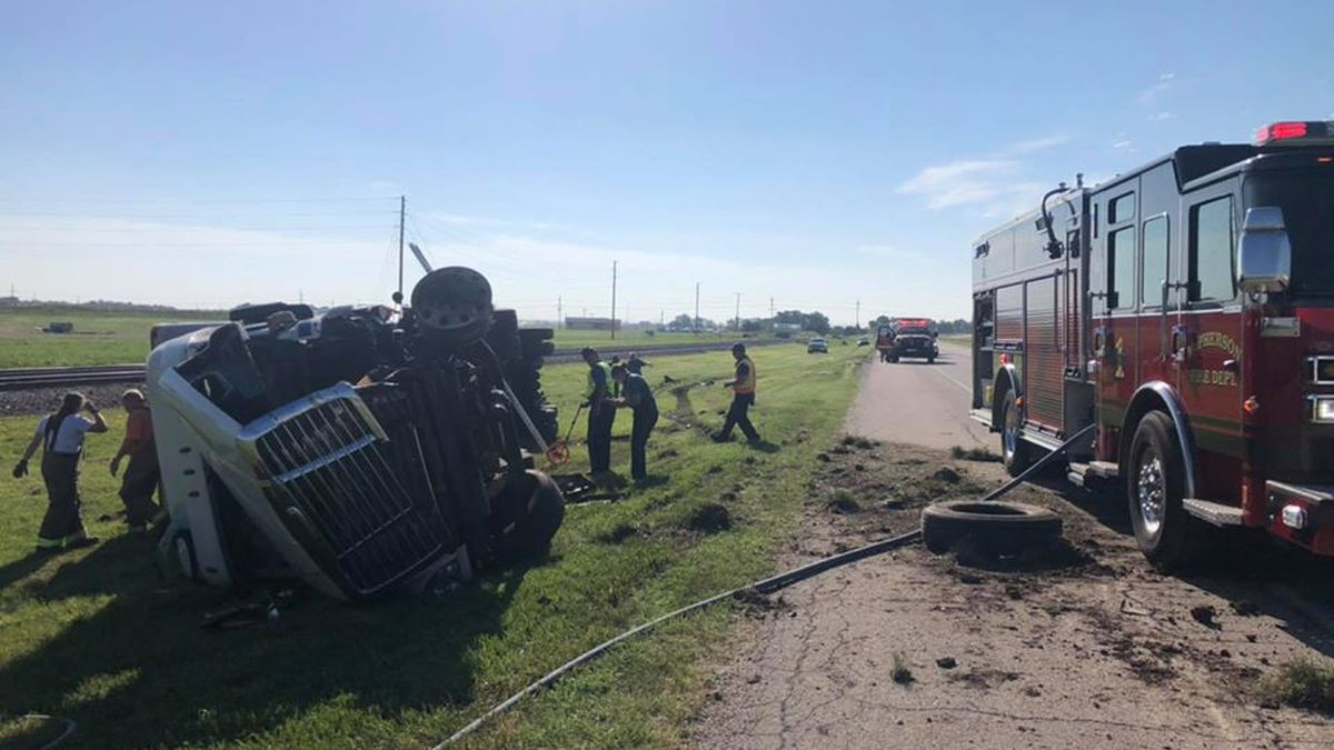The driver of the semi that tipped over was lifelighted to the hospital but able to talk to responders, according to the Kansas Highway Patrol.