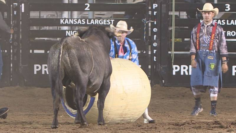 Two Kansas bull fighters work the Pretty Prairie Rodeo together.