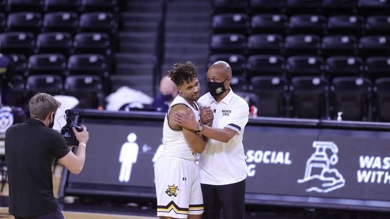 Wichita State sophomore guard Tyson Etienne gets a hug from Shocker interim head coach Isaac...