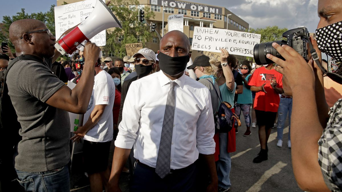 Kansas City mayor Quinton Lucas, center, walks among protesters Wednesday, June 3, 2020, in Kansas City, Mo., during a unity march to protest against police brutality following the death of George Floyd, who died after being restrained by Minneapolis police officers on May 25. (AP Photo/Charlie Riedel)